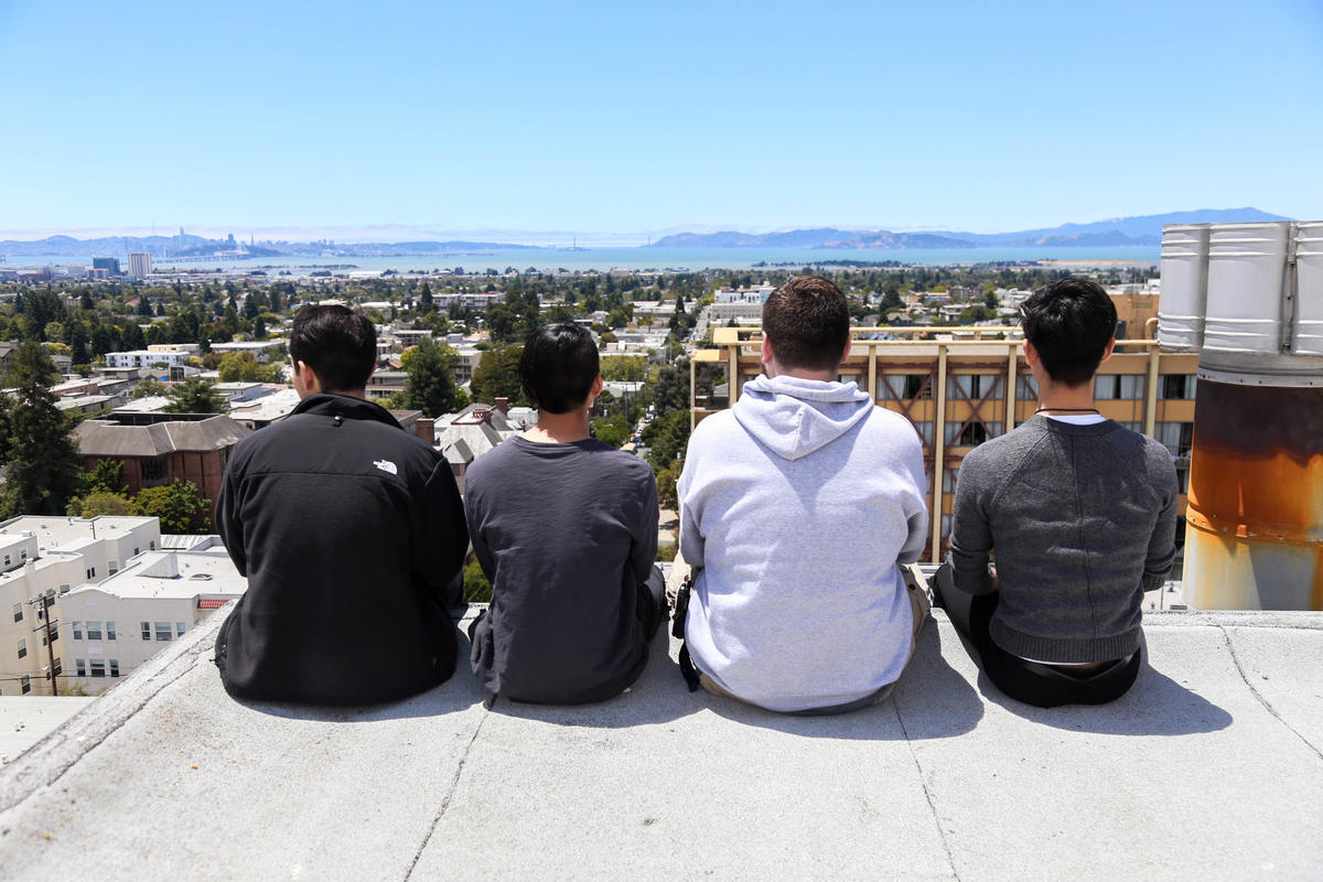 Network Engineering team facing a view of campus atop the STS building